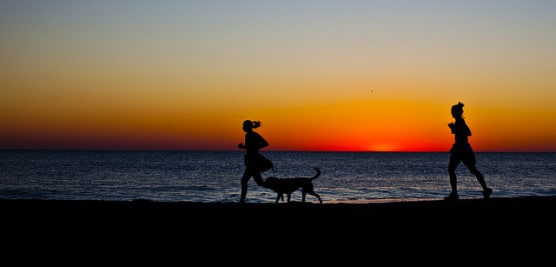 Runners at sunrise along the beach in Rehoboth Beach, Del. (Photo by Owen Byrne/flickr)