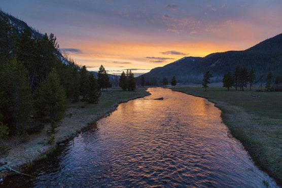Sunset on the Madison River in Yellowstone National Park. (NPS/Neal Herbert)