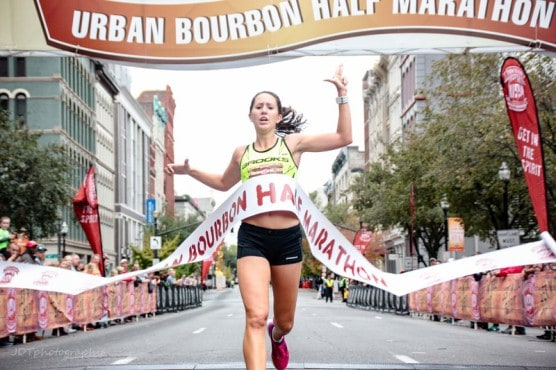 Crossing the finish line first in 2015. (Photo courtesy Urban Bourbon Half Marathon)