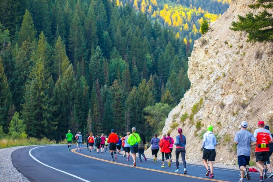 Runners make their way along Highway 190 at the Revel Big Cottonwood Half Marathon. (Photo courtesy RunRevel)
