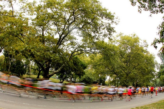 Runners pass by in a blur during a 2013 half marathon in New York's Central Park. (Photo by Phil Roeder/flickr)