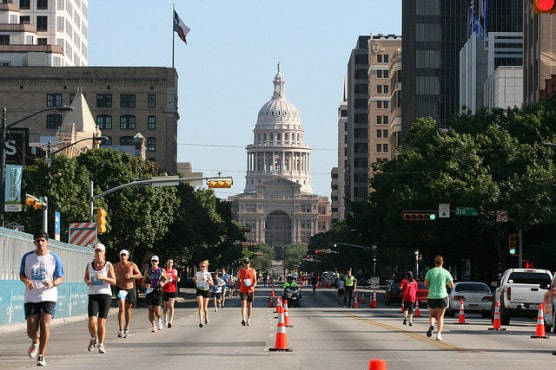 Runners in the shadow of the Texas Capitol building at the 2009 Austin Marathon. (Photo by Roger Mommaerts/flickr)