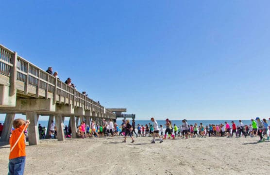 Runners make their way along the beach at the Critz Tybee Run Fest. (Courtesy Critz Tybee Run Fest)