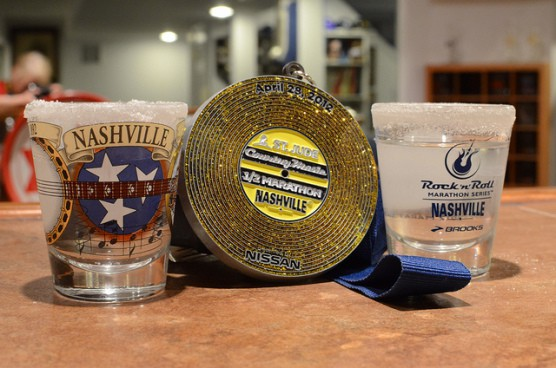 Shot glasses and a finisher's medal from the 2012 St. Jude Country Music Marathon & Half Marathon, just a few of the race goodies given out. (Photo by slgckgc/flickr)
