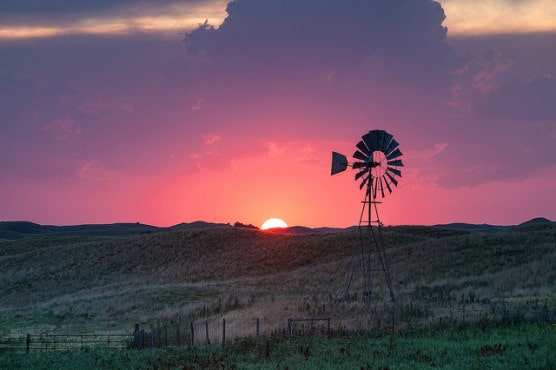 A windmill at sunset in Valentine, Nebraska. (Photo by Kelly DeLay/flickr)