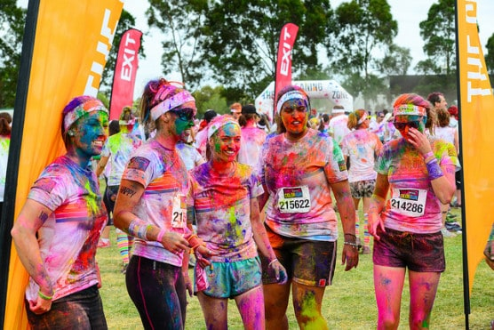 Runners gather at the finish line of the Color Run in Melbourne, Australia, in March 2014. The Color Run 5K will be part of the Hospice Half in 2015. (Photo by Chris Phutully/flickr)