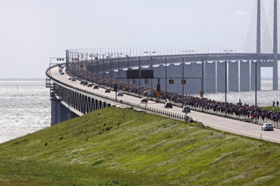Runners make their way between Denmark and Sweden at an annual bridge race there in June 2010. (© Kim Carlson | Dreamstime.com)