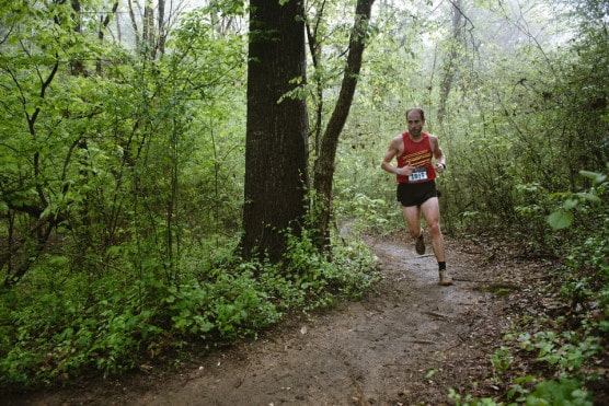 a runner treks the trails through north carolina s u s national whitewater center at the 2015 tuck