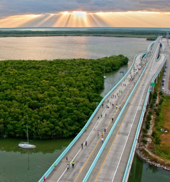Entrants in the Key Largo Bridge Run reach the apex of the Jewfish Creek Bridge on the Florida Keys Overseas Highway Saturday, Nov. 10, 2012, in Key Largo, Fla. The event attracted 885 participants who competed in half-marathon, 5k and 10k divisions. FOR EDITORIAL USE ONLY (Andy Newman/Florid Keys News Bureau/HO)