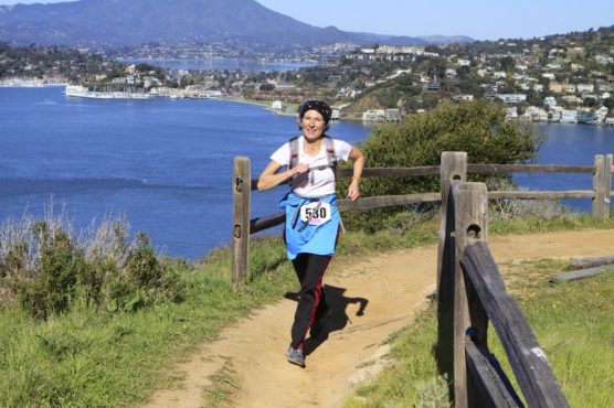 A runner on the trail at the Romancing the Island Half Marathon. (Courtesy Enviro Sports)