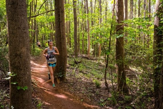 A runner treks the trails through North Carolina's U.S. National Whitewater Center at the Tuck Fest Half Marathon. (Courtesy U.S. National Whitewater Center)