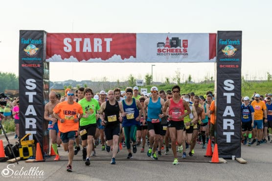 Runners at the start line at the Med City Half Marathon