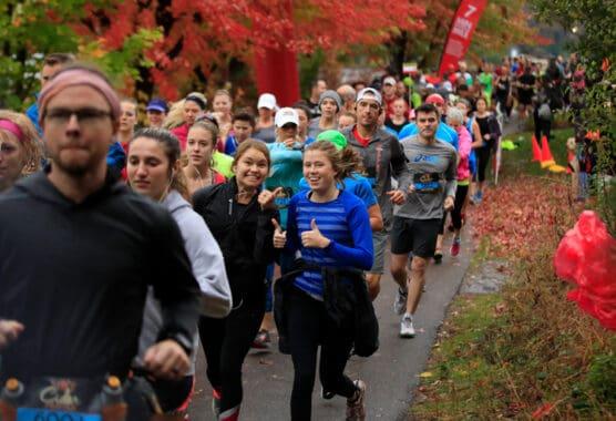 Runners on the course at the Hot Cider Hustle Half Marathon in Omaha, Nebraska.